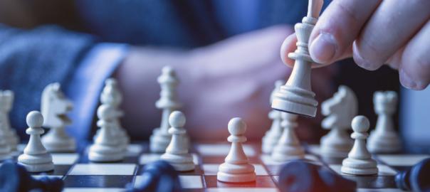 Intelligence. Man playing chess