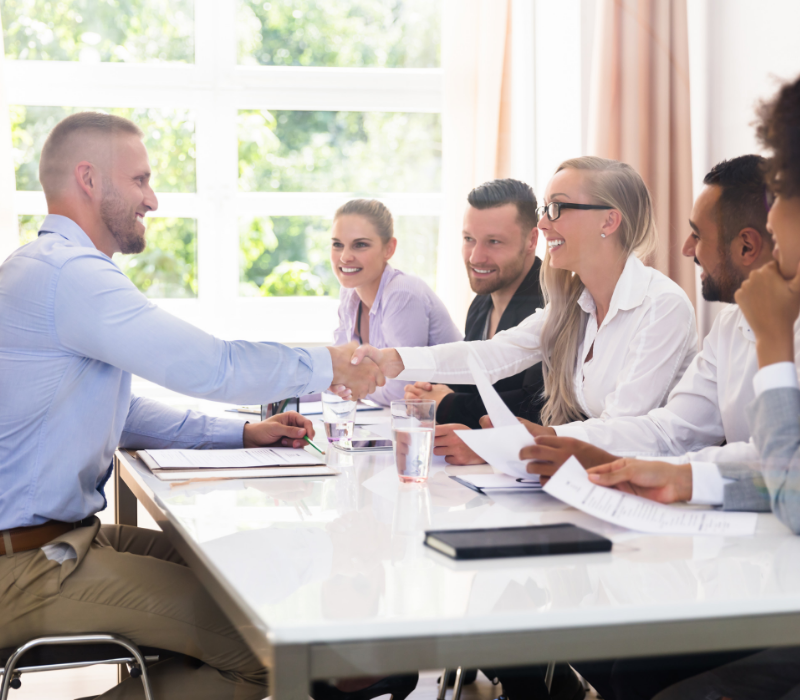 Graduate Interview tips. Candidate shaking hands with panel member