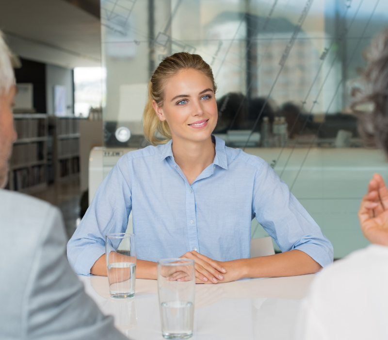 Interview skills guide. Young candidate at table.