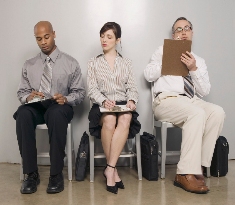 Interview Skills Guide. 3 candidates sitting in a waiting room.