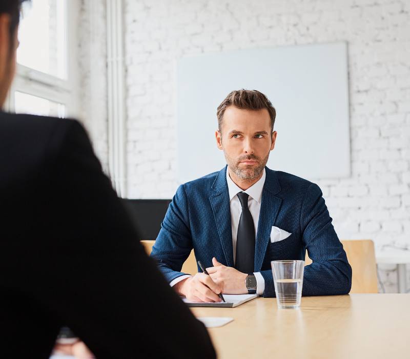 Interview Skills Guide. Interviewer looking sceptical