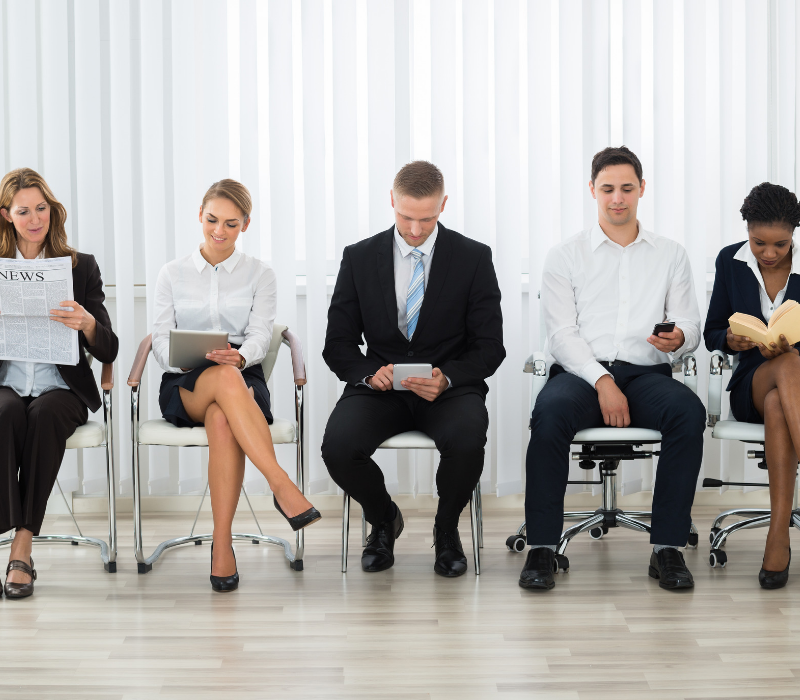 Interview Skills GUide. Candidates sitting ina waiting room waiting for an interview.