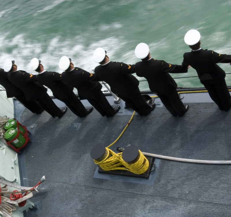 Royal Navy Recruitment Tests. Marines standing on the side of a ship