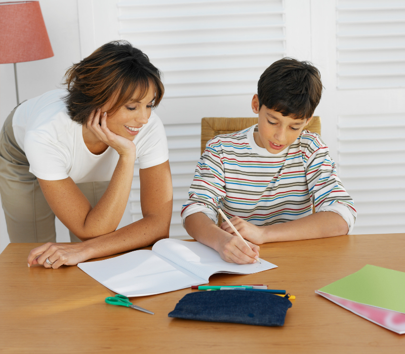 11 plus tutoring costs. Tutor helping boy