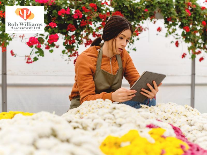 Graduate Digital Literacy. Business owner on tablet.