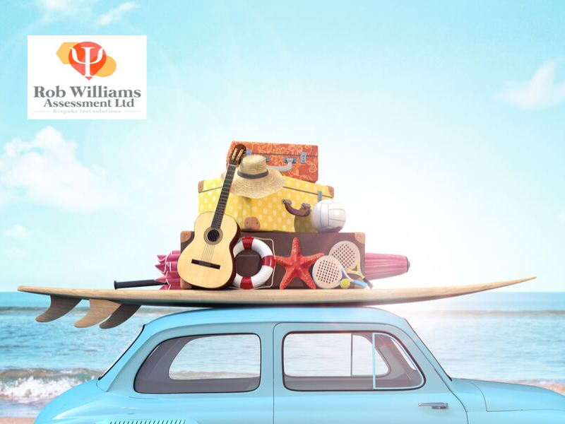 Personality type MBTI tips. Car packed for holiday with beach in the background.