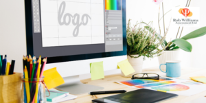 Top design Jobs with picture of desk with coloured pencils and computer screen with logo design.