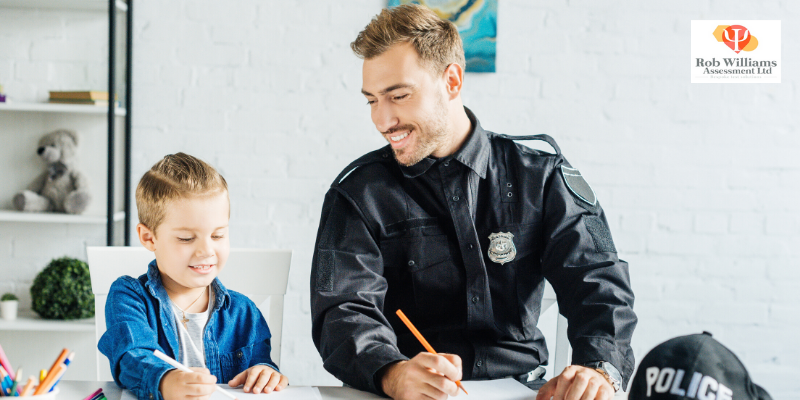 Man in police uniform doing career tests practice with his son.
