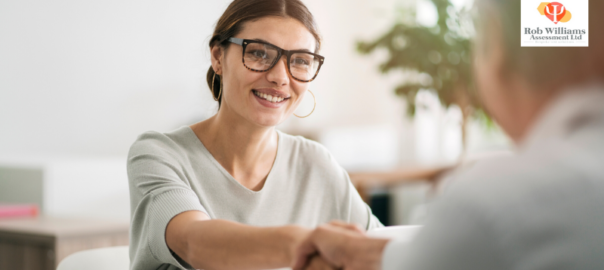 Interview tips for tech jobs. Woman shaking interviewers hand.