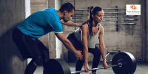 Jobs in PE. Personal trainer helping woman with weights