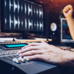 Jobs in Music. Producer at sound board.
