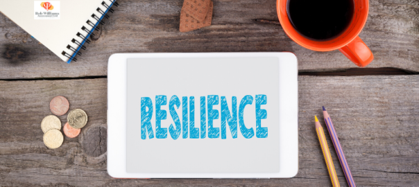 Desk top with Resilience skills in blue writing