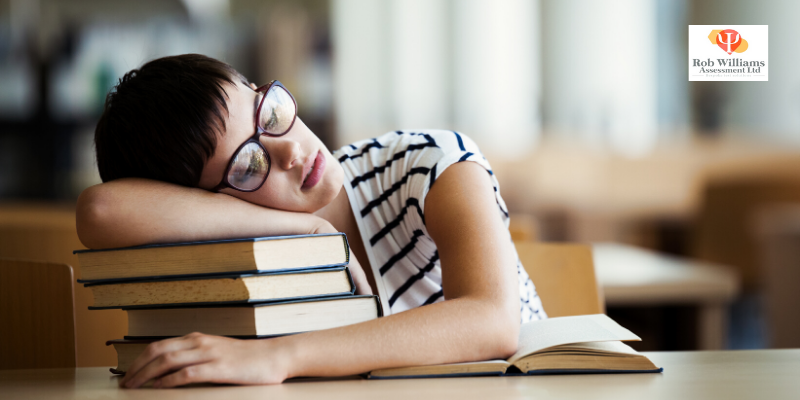Student asleep at books, update for all school and university exams and admissions 2020