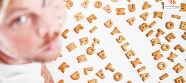Adult Dyslexia tests. Man with biscuits spelling 'dyslexia'